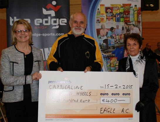 Vanessa Clarke, General Manager of  Pepsico Carrigaline and Pat Twomey, Chairman of Eagle AC presenting a cheque for €400 to Bobbie Lambe of Carrigaline Meals-on-Wheels