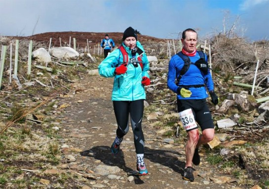 Grellan McGrath with the usual blood splattered legs descending for one of the many peaks on the Wicklow Way Ultra