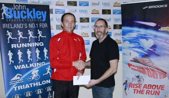 Colm Sheahan (L)...winner of the 2014 Cheetah Run receiving his prize from Jor Roche (R) of Eagle AC