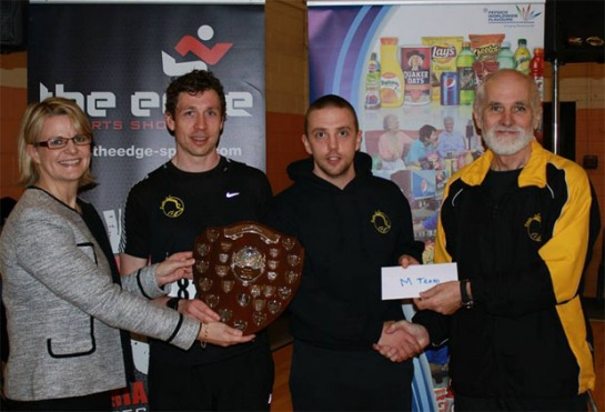 Vanessa Clarke, General Manager of  Pepsico Carrigaline and Pat Twomey, Chairman of Eagle AC presenting the prize for the winning mens team to Eagle AC