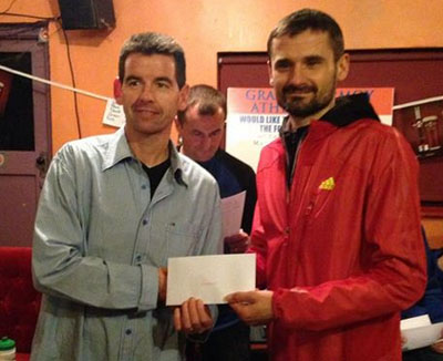 Pat O'Connor (L) receiving his 2nd M45 prize from Sergiu Ciobanu, one of the top marathon runners in the country