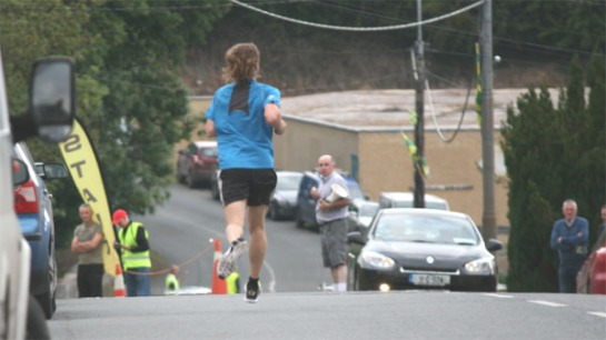 John O'Callaghan on his way to the finish line to win the 2015 Ballyclough Harbour 5k